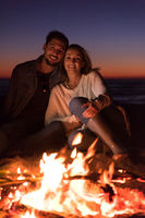 portrait of young Couple enjoying  at night on the beach