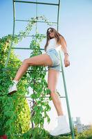 Young beautiful girl posing outdoors.