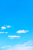 Blue sky with white clouds -  vertical background