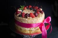 sponge cake with berries on dark