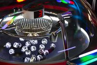 Black and white lottery balls in a rotating bingo machine. Number 3