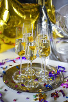 Close up of shiny glasses of champagne over party background