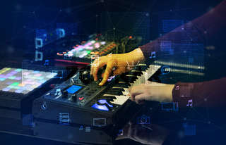 Hand mixing music on midi controller with play music and multimedia concept