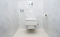 Modern tiled WC or toilet bowl wall mounted