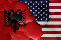 flags of Albania and USA painted on cracked wall