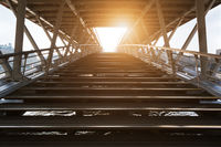 Stairs of solferino bridge against sun in Paris
