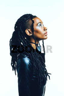 Profile of a woman with long dreadlocks looking up