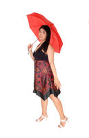 Chinese woman standing with a red umbrella in the studio