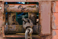 rusty fairlead with anchor chain
