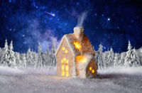 Small house with winter landscape and starry sky