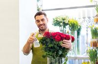 florist or seller setting red roses at flower shop