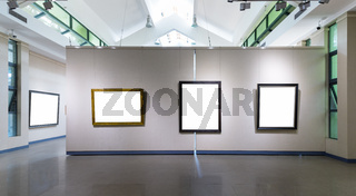 blank frames on exhibition wall in a room
