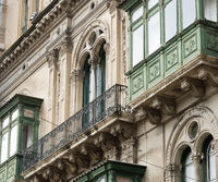 Fragment Of A Building With Windows And Balconies In Maltese Baroque Architecture Style