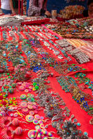 Large selection of a range of style of earrings and jewellery on a market stall for sale.
