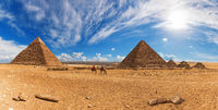 Bedouins near the Pyramids of Giza, sunny day panorama