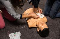 First Aid Training. Defibrillator CPR Practice