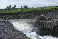 DHARNI, AMRAVATI, MAHARASHTRA, August 2018, Fisherman fishing with nets at Utawali waterfall at Utawali Village.