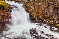 Powerful streams with a roar break