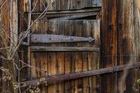 Old wooden door. Brown wooden surface picture of the door.