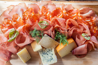 Rustic plate with sausage, ham and cheese