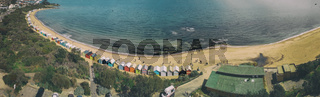 Panoramic aerial view of Brighton Beach colorful huts, Victoria, Australia