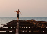 pier destroyed old iron traveler man goes to the sea extreme holidays