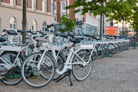 Bicycle rental on the street in the city center. Bike is a popular way of transport in the city of C