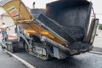 Asphalting works of a road with an asphalt paver