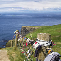 Cliffs of Moher fence with badges