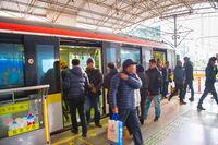 People leaving train Shanghai Metro