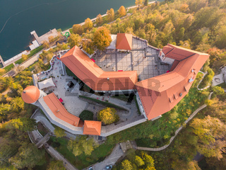 Top down view of medieval castle on Bled lake in Slovenia in autumn.