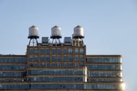 some typical water tanks on the roof of a building in New York City