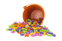 Orange bucket with many letters