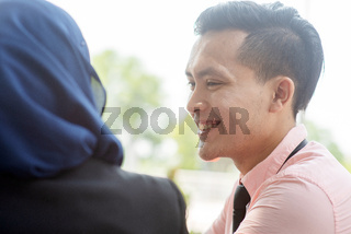 Business people talking and smiling