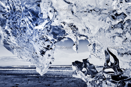 view through glacial ice on the sea , Diamond Beach, Breidamerkursandur, Iceland, Europe