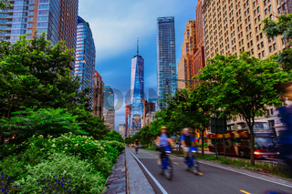 Hudson River Greenway and cyclists with One WTC view in New York City