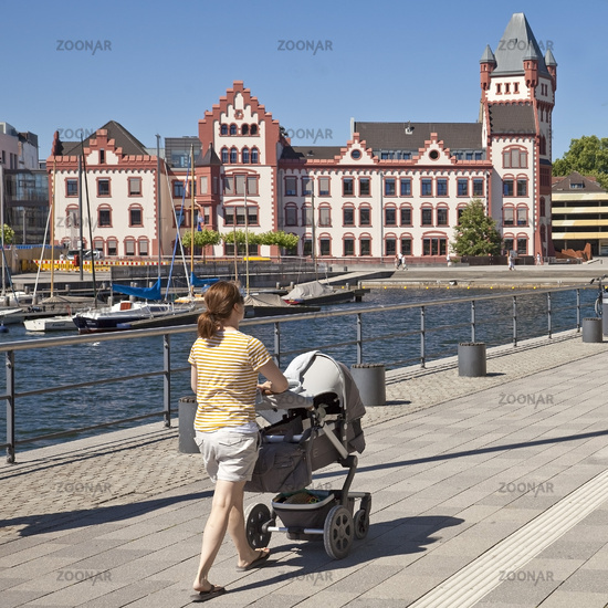 mother with castle Hoerde at Phoenix Lake, Dortmund, North Rhine-Westphalia, Germany, Europe