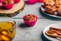 Oatmeal muffins with cup of green tea.
