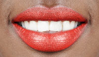 beautiful smile african woman mouth lips with red lipstick and white teeth