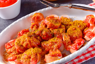 a traditional currywurst in delicious curry sauce