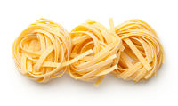 Raw Tagliatelle Pasta Nests Isolated On White Background