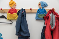 Children's wardrobe with child-friendly clothes hooks and kids jackets - close-up