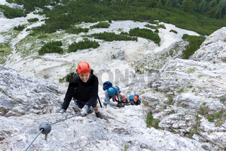 group of climbers on a Via Ferrata in the Dolomites of Alta Badia