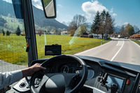 View through the driver's window of a bus