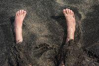 Children's feet on the sand