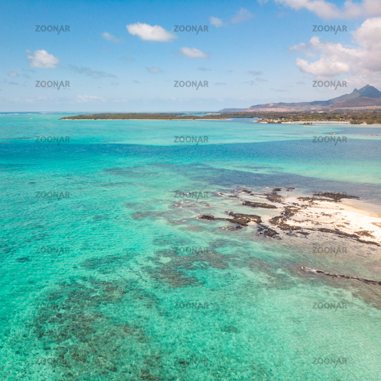 Aerial view of beautiful tropical beach with turquoise sea. Tropical vacation paradise destination of D'eau Douce and Ile aux Cerfs Mauritius