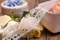 White lace on the table among roses view