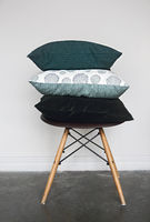 Green pillows on the chair