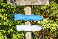 Wooden arrow sign with arrows in colors