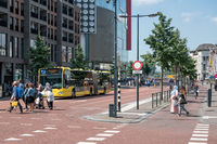 Cityscape Dutch city Utrecht with urban bus waiting for people